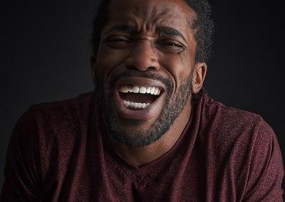 laughing black man with beard.